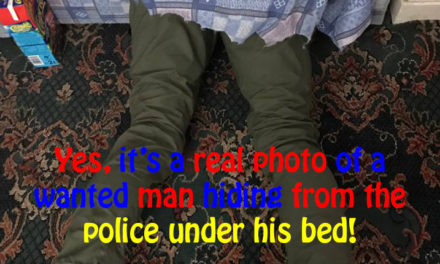 Yes, it's a real photo of a wanted man hiding from the police under his bed!